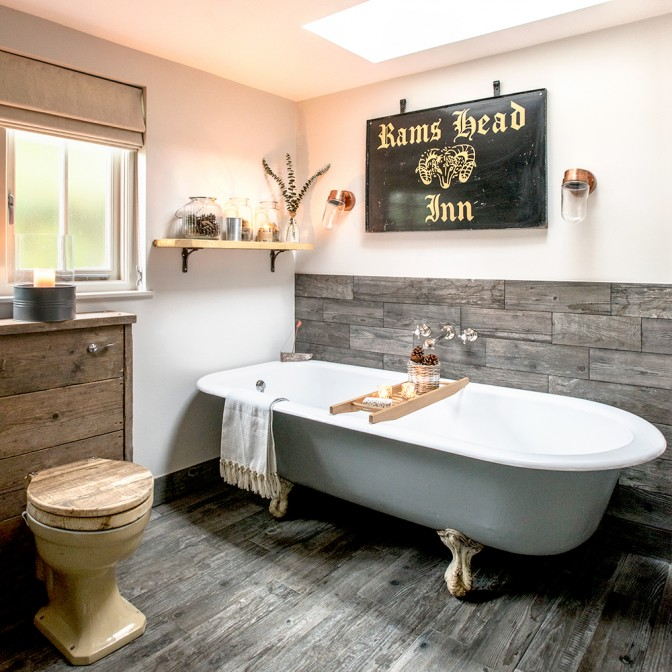Country bathroom with reclaimed wood panelling
