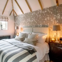 Cosy country bedroom with eyecatching wallpaper