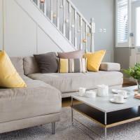 Small grey living room with corner sofa