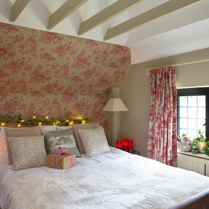 Guest bedroom with red Toile de Jouy wallpaper
