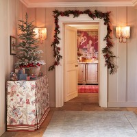 Traditional hallway with Christmas tree and garland