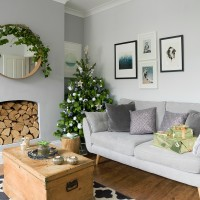 Modern pale grey living room with Christmas tree