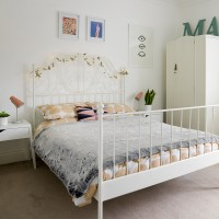 Pretty white bedroom with decorative metal bed