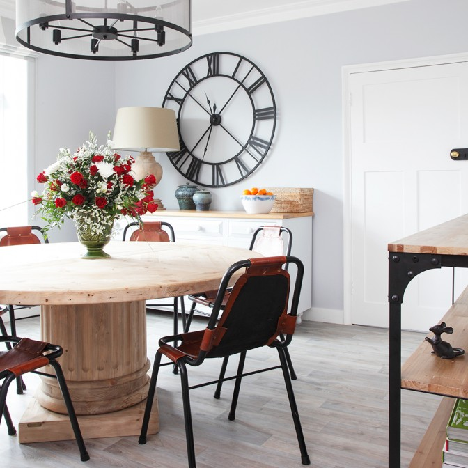 White dining room with decorative clock