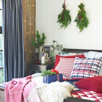 Christmas bedroom with sleigh bed and patchwork throw