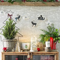 Scandi-inspired hallway with festive display and statement wallpaper