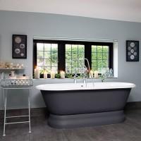 Classic grey bathroom with roll-top bath