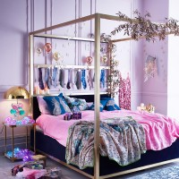 Pink and gold bedroom with nature-inspired prints