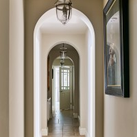 Arched hallway with flag-stone floor