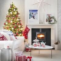 Christmas living room with wood burner and ski theme