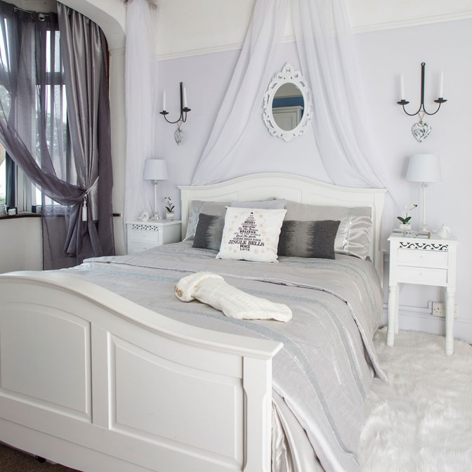 Festive master bedroom in white and silver