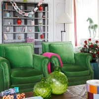 Quirky green Christmas living room with twin armchairs