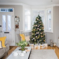 Festive living room with a golden finish
