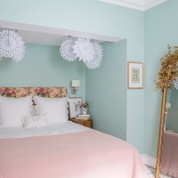 Scandi children's room with mint green wall floral headboard