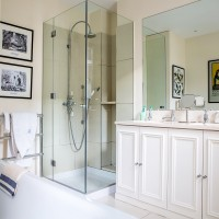 Simple Scandi shower room with classic vanity unit